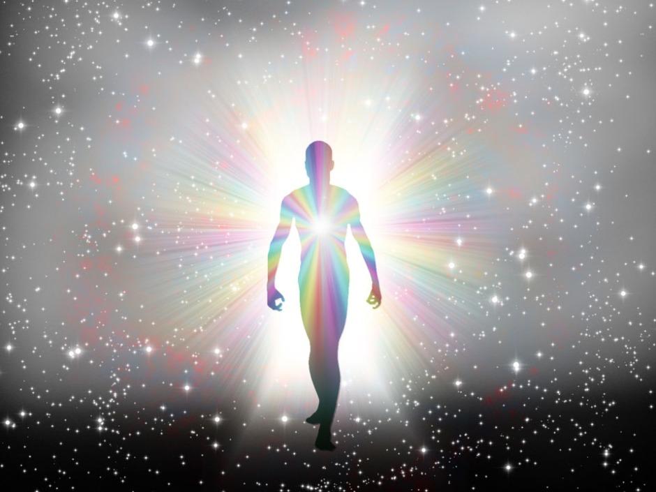 Man in rainbow light and stars